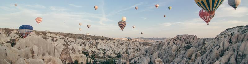 Turkey, Cappadocia, Balloons over valley