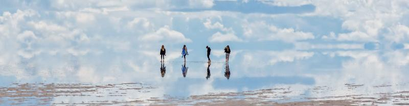 Four travellers explore the salt flats of Bolivia