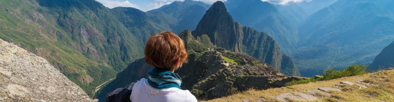 GGPIC - Woman admiring Machu Picchu from a distance