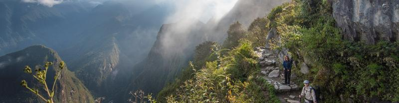 Travellers trek scenic view along Inca Trail, Peru