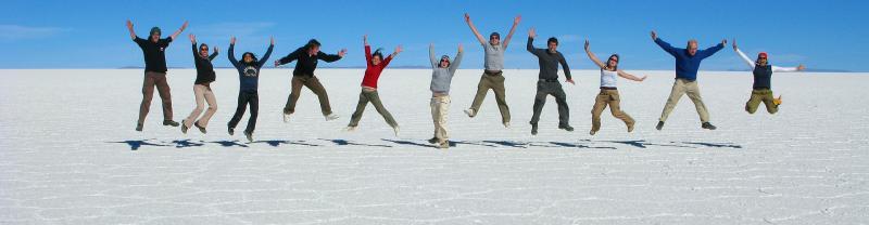 Group of travellers jumping on salt flats, Salar de Uyuni, Bolivia