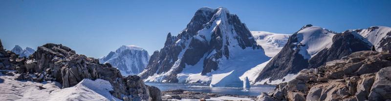Snow capped rocky peaks of Antarctica