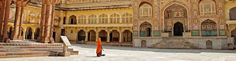 HHPHC - Persona walking through decorative gate of Amber Fort in Jaipur, India