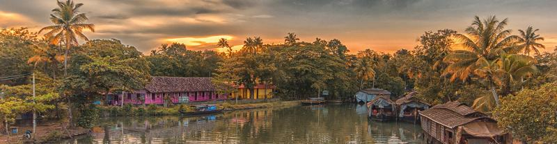 HHPWC - Sunset views of the Kerala Backwaters surrounded by palm trees