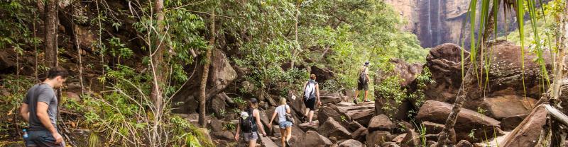 Pax hiking through Kakadu with local leader