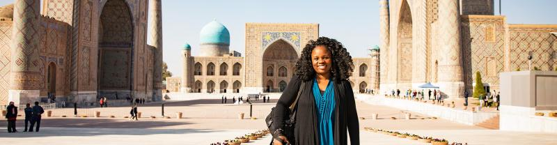 KFPU - Pax smiling in front of Registan Square in Samarkand, Uzbekistan