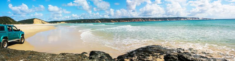 PAKF - The coast of Rainbow Beach with a 4x4 vehicle in Queensland, Australia