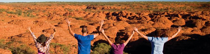 Group posing in front of Kings Canyon, Northern Territories Australia