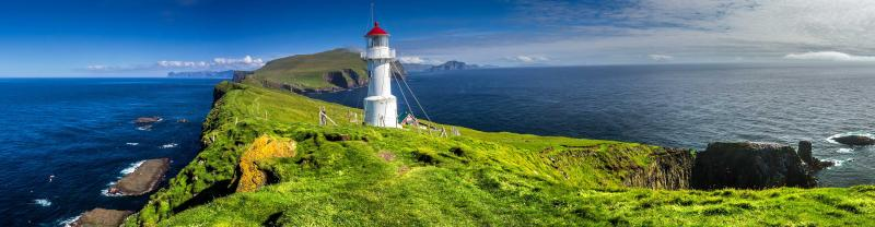 Panoramic view of Old lighthouse on the beautiful island Mykines, Faroe islands