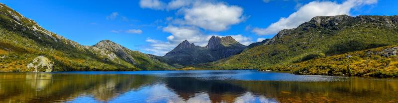 Reflection of Cradle Mountain on water located in Tasmania, Australia
