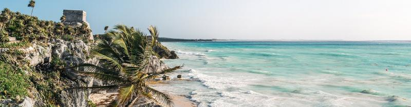 QBPN - Ruins and beach with palm trees in Tulum, Mexico