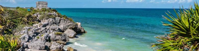 View of blue ocean and rocky coastline of Tulum