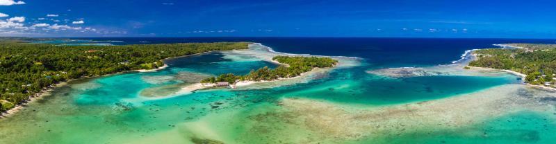 A wide aerial shot of a coastline in Vanuatu