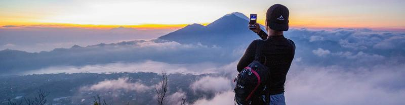 Watch the sunrise from Mt Batur, on the Essential Bali & Gili Islands trip with Intrepid Travel