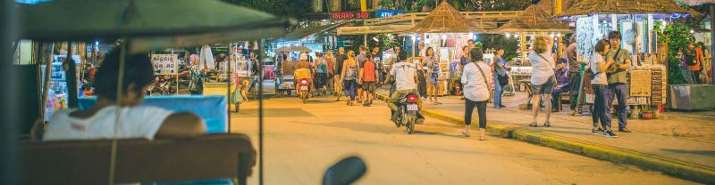 A lively street at night in Siem Reap, Cambodia