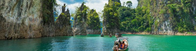 Travellers cruising through Khao Sok by boat