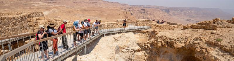 XEPIC - Group lookout over clifftop fortresses of Masada, Israel