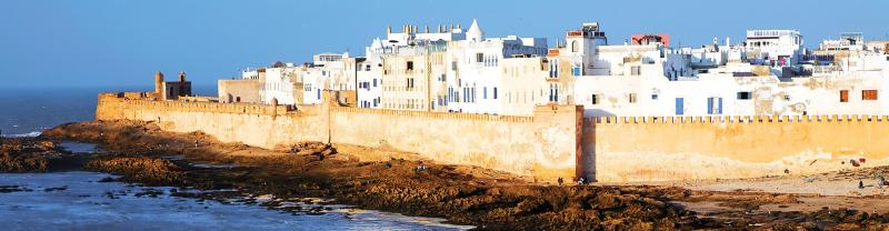 Cliffside view of fortress walls in Essouira city beside the sea, Morocco