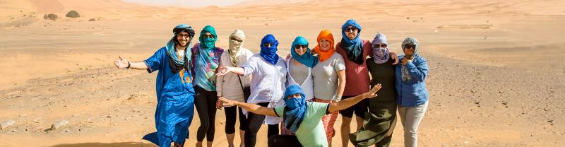 Intrepid Travel group posing in Sahara Desert, Morocco