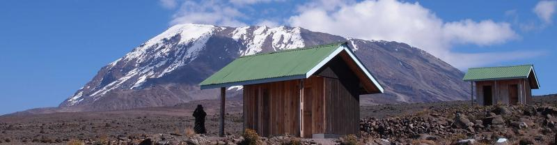 Traveller takes in view at Mount Kilimanjaro huts in Tanzania
