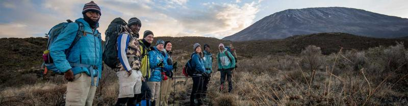 Hikers trek towards Mount Kilimanjaro