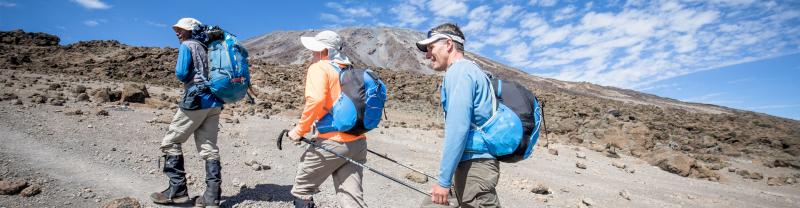Travellers begin the hike to Mount Kilimanjaro