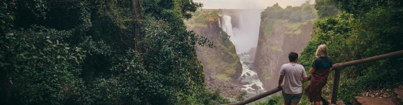 Travellers take in the view of Victoria Falls