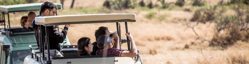 Travellers on board safari through the Serengeti