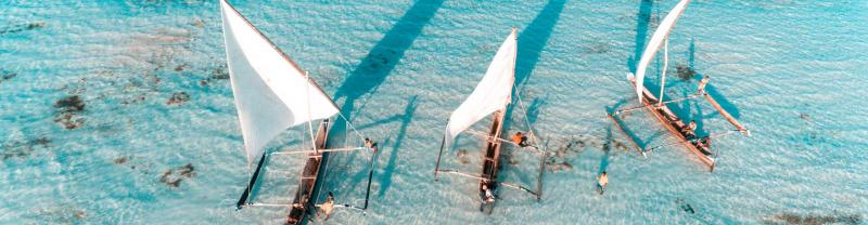 Aerial view of fisherman on the clear waters of Zanzibar