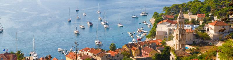 Aerial view of Hvar Island harbour, boats and architecture