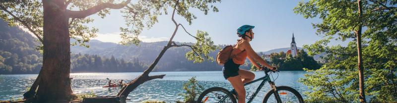 Traveller rides bike around Lake Bled
