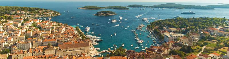 Aerial drone shot view of sailing boats cruising the Dalmatian Coast, Croatia
