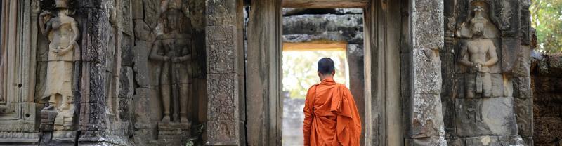 cambodia angkor temple monk walking doorway