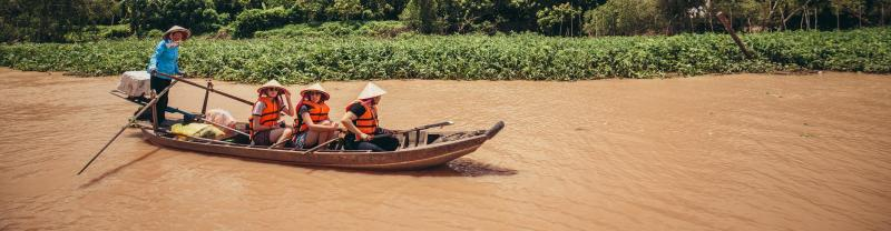 gteac_vietnam_mekong-river_canoe_smiling-pax_banner
