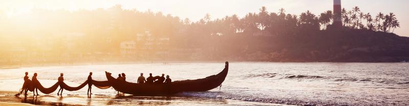india kerala boats beach sunset silhouettes