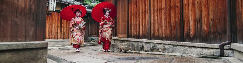 japan two geishas umbrellas