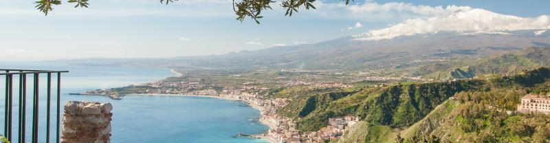 Mount Etna seen from a viewpoint of the roman theater in Taormina, Sicily