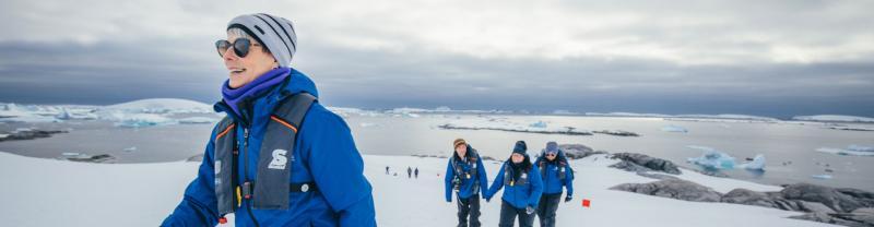 Passengers go for a walk on an Antarctic island