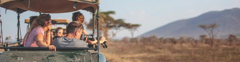 Jeep safari on African plains