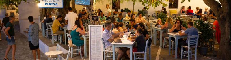 Settling in for dinner at a restaurant in Greece
