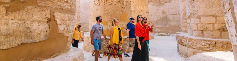 Travellers wander through the Luxor temples, Egypt