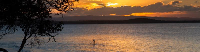 A paddle boarder in Noosa on the east coast of Australia