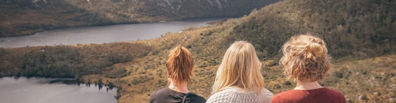 Three women looking out at the view from Cradle Mountain