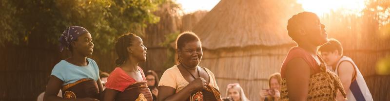 Local tribe women dancing in Botswana
