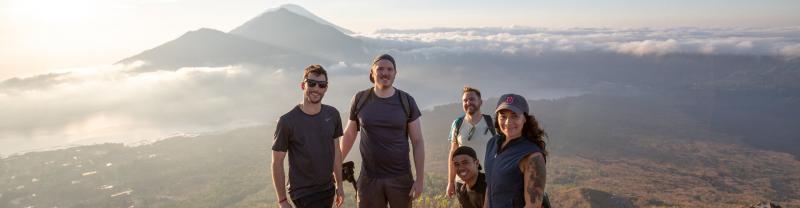 Travellers standing on summit of Mount Batur