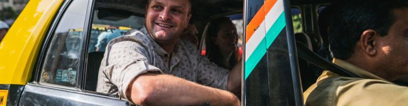 A traveller takes a taxi in Mumbai, India
