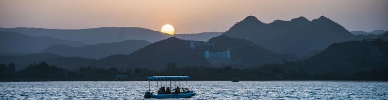 A boat on the water at sunset in Udaipur
