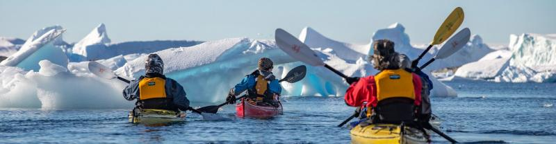 People kayaking in Antarctica