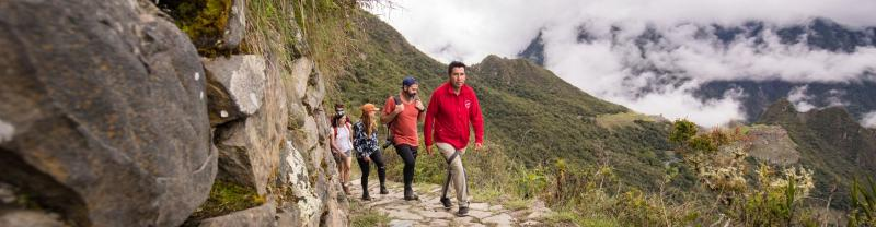 Leader and group in Machu Picchu