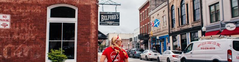 Intrepid Leader walks down the street in Savannah, Georgia